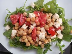 Tomato, Chickpea and Feta Salad - is perfect for any kind of summer weather. It's also a salad that my kids love and it's hearty enough that with a small piece of fish, it's a full meal that is quick and requires almost no heat at all.