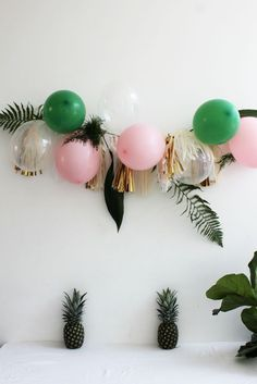tropical pineapple party with ferns / balloon garland in pink and green with ferns