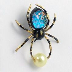 i hate spiders, but i love spider jewelry...