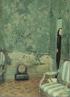 Pauline de Rothschild photographed in her Paris apartment behind a secret jib door perfectly hidden in a wall entirely wrapped by an ancient chinoiserie wallpaper. Photography taken by the famous German photographer, Horst. #jibdoor #interiordesign - More wonders at www.francescocatalano.it