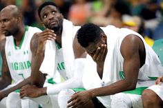 Team Nigeria not feeling the love back home:  August 20, 2016  -     Nigeria's Alade Aminu, left, Ekene Ibekwe, center, and Chamberlain Oguchi, right, sit on the bench during the final moments of a men's basketball game against Brazil at the 2016 Summer Olympics in Rio de Janeiro, Brazil, Monday, Aug. 15, 2016.