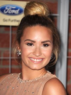 We're all about a matchy-matchy moment and Demi's sun-kissed glow complements her sun-kissed top-knot perfectly! The trick to achieving the X Factor when it comes to this 'do is not to over-think it. The more undone the better!