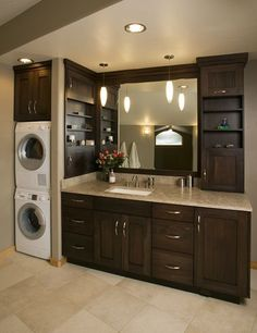 1000 ideas about laundry in bathroom on pinterest wall mounted sink dividing wall and in for Washer and dryer in bathroom designs