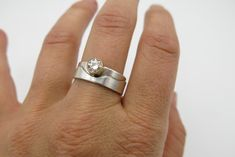 This ring features a goregous piece of near colorless moissanite, set in gold, and stands on the Sangre de Cristo mountains of Santa Fe. Order your custom mountain ring today. Heart Of The Desert, Moissanite Rings, Santa Fe, Band Rings, Wedding Rings, Engagement Rings, Mountains, Sterling Silver, Gold