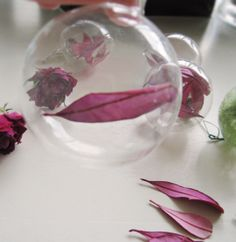 diy christmas ornaments+glass balls filled with rose petals and colored leaves | Flickr - Photo Sharing!