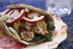 Seitan Gyros Recipe with olive oil, onion, garlic, seitan, dried oregano, ground cumin, cucumber, dressing, pita bread, lettuce, plums, soy yogurt, vegan mayonnaise, lemon, all purpose seasoning, fresh dill