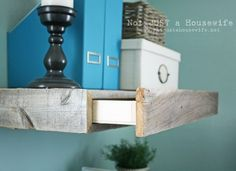 Fabulous reclaimed wood shelves with a hidden drawer,