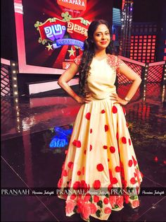 Purnima indrajit wearing a modern skirt and blouse designed in red roses in ugram ujalum                    costume by prannah