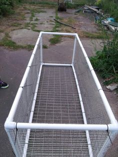 Rabbit run. Pvc pipe frame with wire sides. This link shows a small door on top, I'd rather the whole to open.