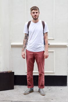 Coggles Fashion - London Street Style with plain t-shirt, brown rucksack, red chinos and grey trainers.    #streetstyle #fashion #tattoos