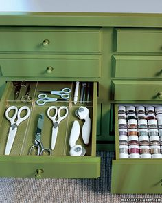 Slice-and-fit acrylic dividers keep scissors and other small tools in order. A graduated spice rack organizes the many jars of glitter.