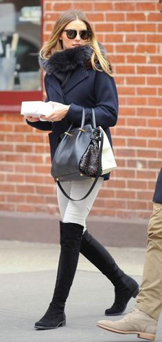 Over-the-knee boots are one of Olivia Palermo's favorite fall trends - come see how she suggests styling them with jeans and for the office, plus more outfits she loves.