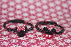 Disney Beaded Bracelet, Mickey Mouse, Minnie Mouse, Beaded Bracelet  Memory Wire Single Loop Bracelet    These bracelets will work great with any outfit. They make great gifts!    This simple, yet elegant, bracelet/cuff is handcrafted from a single loop of high quality brass and coated with silver memory wire which will retain its shape. The memory wire makes it easy on and easy off!!!     It is made with memory wire and seed beads. Memory wire bracelets are very comfortable and easy to…