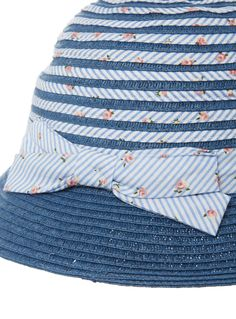 This striped cloche hat is an essential warm weather staple. With a pretty floral print and a bow detail, this accessory will quickly become a daily favourite. Girls blue cloche hat Striped design Floral print Bow detail Keep away from fire