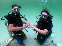Scuba newbies - showing their love for scuba....and each other.