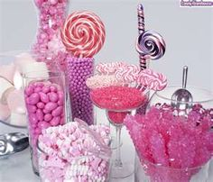 Close-up photo of a pink candy buffet featuring: Giant marshmallows, taffy, jordan almonds, chocolate      www.flickr.com