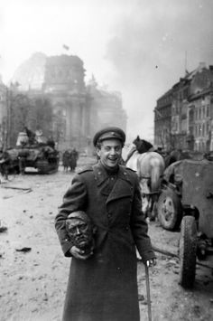 "historicaltimes: "" A Soviet soldier carries a souvenir during the Battle of Berlin. April 1945. """
