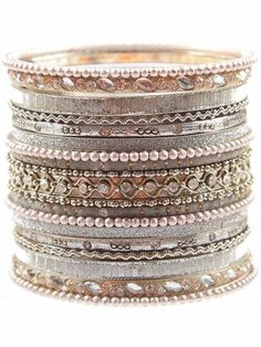 Silver bangles signify strength in India, and this set of artisanal arm candy from Merchant Society is an ornamental tour de force. Wear this Mumbai bangle set when you want to enrich an everyday look with a textured, exotic touch.  soooooooooooooooo want this!!!!
