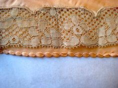 Lace applique and fancy hem seen from the inside work on 1930's knickers