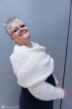 """Crochet Poncho woman wearing a scarf wrapped around her shoulders - This scarf is long. It is wide. It is plush, cozy, and warm. I named it """"Give me a Hygge"""" because of the way you pronounce the yarn: Hoo-gah Crochet Shrug Pattern, Poncho Knitting Patterns, Crochet Shawl, Crochet Patterns, Scarf Patterns, Knit Cowl, Hand Crochet, Crochet Poncho With Sleeves, Crochet Shrugs"""