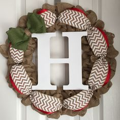 """Monogram Holiday Wreath for Front Door - Holiday Burlap Wreath - Red and Green Burlap Wreath - Holiday Door Hanger - Monogram Door Hanger. Burlap monogram holiday wreath made on a 16"""" wire frame. The finished product is about 20"""" in diameter. Each wreath is handmade and may differ slightly from the example shown in the photo. I make every effort to ensure each wreath is full and even. All my wreaths are made to order so please allow 1-2 weeks of processing time. Thank you for your…"""
