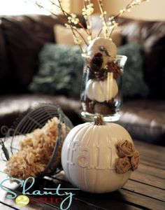 Fall Centerpiece - Spray painted pumpkins and pine cones by Ashley at www.shanty-2-chic.com #Fall #Decoration #Pumpkin