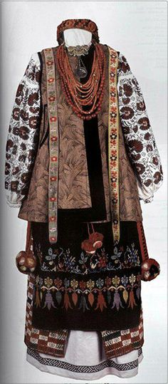 Absolutely stunning outfit from the Ukraine - I just love everything about it - colour, pattern, texture, layers!