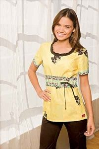 """Dickies Round Neck Scrub Top in """"Break of Dawn"""" 82769C-BDAW A Junior fit smocked round neckline top features an adjustable front tie, back elastic, side angled pockets and side vents. Center back length: 26 1/2"""". $22.05 #scrubs #scrubcouture #nurses"""
