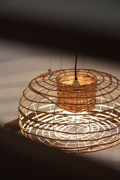 "Feature Pendant Light ""Urchin"" light by Cielo Design Studio. Available from https://www.etsy.com/au/shop/CieloDesignStudio Pendant lighting, cane wire basket, lobster cage, stainless steel fittings and black adjustable height cord length."
