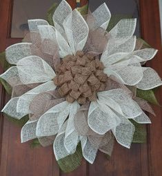 This country sunflower is made with antique white and natural poly burlap for the petals and olive green poly burlap for the leaves the center is created with traditional burlap it is approximately 26 in diameter and can be safe for outdoor display p Burlap Rosettes, Burlap Flower Wreaths, Sunflower Wreaths, Deco Mesh Wreaths, Holiday Wreaths, Burlap Wreath, Burlap Projects, Burlap Crafts, Wreath Crafts