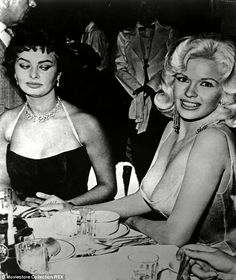 The photo that raised millions of eyebrows: Sophia Loren gave a disapproving look at Jayne Mansfield in 1957 during a cocktail party at the Beverly Hills Hotel; the beauty told Entertainment Weekly she was 'afraid' of the blonde's cleavage
