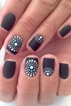 Stylish black nails with dotted circles
