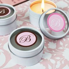Handmade candles in small tins, good for party favors, could be personalized for event or packaged in a 'tube' with like scents/colors