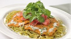 Cheesecake Factory's Chicken Bellagio Recipe ~ Crispy Coated Chicken Breast over Basil Pasta and Parmesan Cream Sauce Topped with Prosciutto and Arugula Salad. Recipe shared by The Cheesecake Factory Breaded Chicken, Lemon Chicken, Creamy Chicken, White Chicken, Chicken Chili, Creamy Pasta, Crusted Chicken, Cheese Cake Factory, Restaurant Recipes
