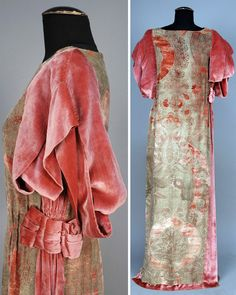 Stenciled velvet gown ca. 1920s. Dusty rose silk with asymmetrical, stylized silver floral. Short sleeves, comprising wide velvet bands and left side insert with ruching at waist with bow detail. Neckline bound in metallic thread. Whitaker Auctions