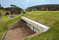 Hillside dwelling entrenched in the landscape
