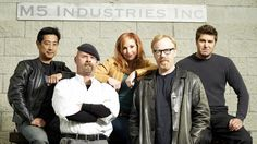 """From left, the cast of Discovery's """"MythBusters"""": Grant Imahara, Jamie Hyneman, Kari Byron, Adam Savage and Tory Belleci at the show's headquarters, the Hyneman-owned M5 Industries in San Francisco. Description from seattlepi.com. I searched for this on bing.com/images"""