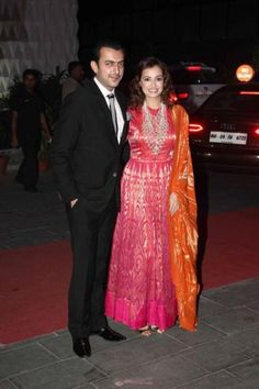 Dia Mirza came with her husband, Sahil Sangha. The actress looked stunning in a red and gold net brocade anarkali by Anita Dongre. We totally loved the way she paired it with a hand woven Banarasi dupatta. - bollywoodshaadis.com