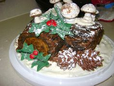 Heidi's version of Buche de Noel: a chocolate roulade cake filled with homemade coffee cheesecake and chocolate ganouche, covered with whipped mocha buttercream. The pine cones are espresso truffles with almonds stuck inside to look like pine cones and covered with chocolate, mushrooms are meringue, and holly berries are candy