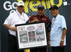 Frank Manzo gets an award at Maple Grove Raceway