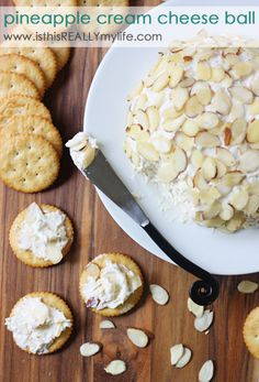 Pineapple cream cheese ball - the cheese ball is coming back and this recipe is leading the charge! So yummy - crushed pineapple is the secret ingredient. #pineapple #creamcheese via isthisreallymylife.com