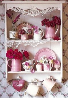 have lace hanging off of the shelves and on the shelf in bedroom
