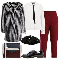 Stile mannish con la camicia bianca, il pantalone rosso a gamba dritta e le derby di vernice. Danno un tocco femminile il basco con le perle e il coat in faux fur a righe, mentre la borsa a blocchi di colore riprende i colori dell'outfit.