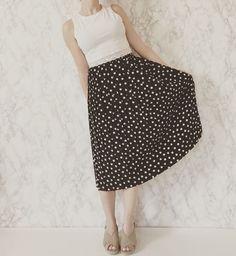 40% OFF SALE... 1970s polka dot pleated midi skirt | black pleated accordion skirt with white polka dots #laurelcompany #conceptshop #vintage #vintageshop #vintageskirt #vintagefashion #vintageclothing #70s #1970s