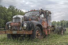 This old 1953 Mack truck with sleeper cab was parked behind a truck stop in a field behind the property. Description from hdrcreme.com. I searched for this on bing.com/images