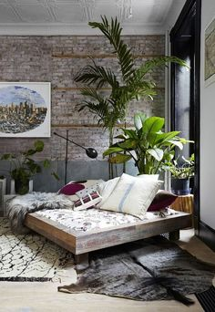 loft bedroom exposed brick walls, lots of light + stamped ceiling | interior design + decorating ideas: