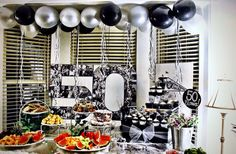 50th Birthday Party.... Just one of the decorated tables at this Black-Silver-White party.  I loved how the balloons and streamers completed the table with the Cupcake display!