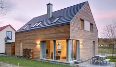House Lillesol, situated by historic spa gardens in the seaside resort of Juliusruh auf Rügen, is set apart by its deep sense of simplicity. The wood-paneled b Converted Barn Homes, Double Sliding Barn Doors, Oak Framed Buildings, Agricultural Buildings, Rustic Luxe, Stone Barns, Modern Barn, House And Home Magazine, Building A House