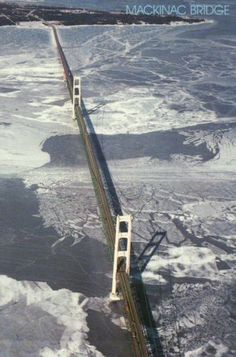 Aerial View of The Mackinac Bridge, Michigan, Winter, Ice + Snow, on Lake Michigan where it meets Lake Huron Michigan Travel, State Of Michigan, Detroit Michigan, Northern Michigan, Lake Michigan, Detroit State, Michigan Facts, Michigan Tourism, Mackinac Bridge