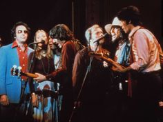 """""""The Last Waltz"""" screen capture, 1978. L to R: Neil Diamond, Joni Mitchell, Neil Young, Richard Manuel, Van Morrison, Bob Dylan, Robbie Robertson.  The Band announced their farewell concert scheduled for Thanksgiving, 1976 and invited many guest artists to join them.  It was suggested that a director named Martin Scorsese would be a good choice to capture a film of the proceedings.  Wise choice."""